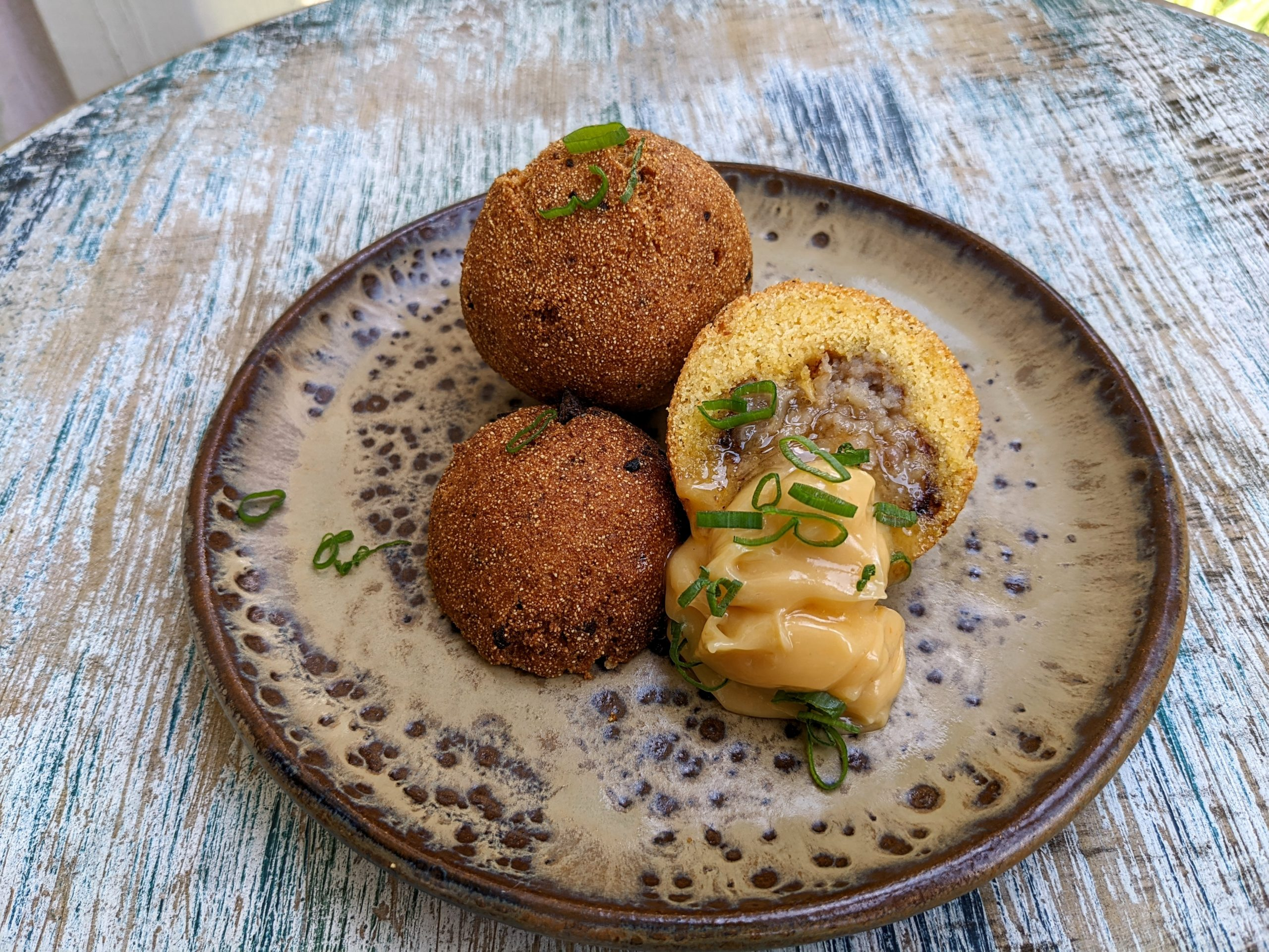 Sausage Stuffed Hush Puppies with Creole Honey Butter