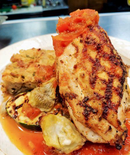 Italian Chicken Breast with Creole Tomato Sauce and Artichoke Bread Pudding