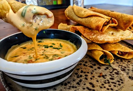 Dirty Rice Taquitos with Creole Cheese Dip